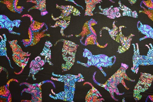 Tossed cats on black background quilting fabric for Quilting Treasures